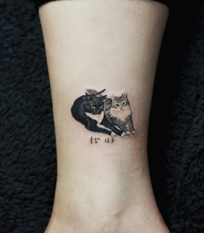 tatouage représentant deux chats