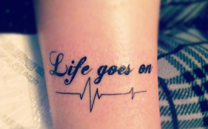 tatouage avec un quote positif