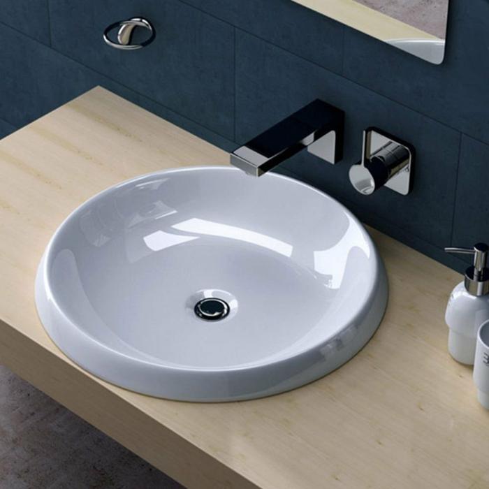 en effet le lavabo vasque à poser fabriqué de porcelaine donne une touche personnelle à votre décoration intérieure