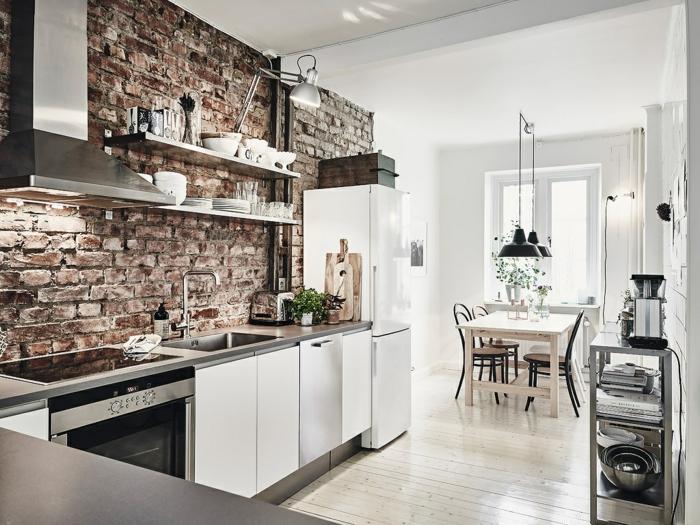 par exemple c'est une cuisine en style scandinave avec un sol blanc