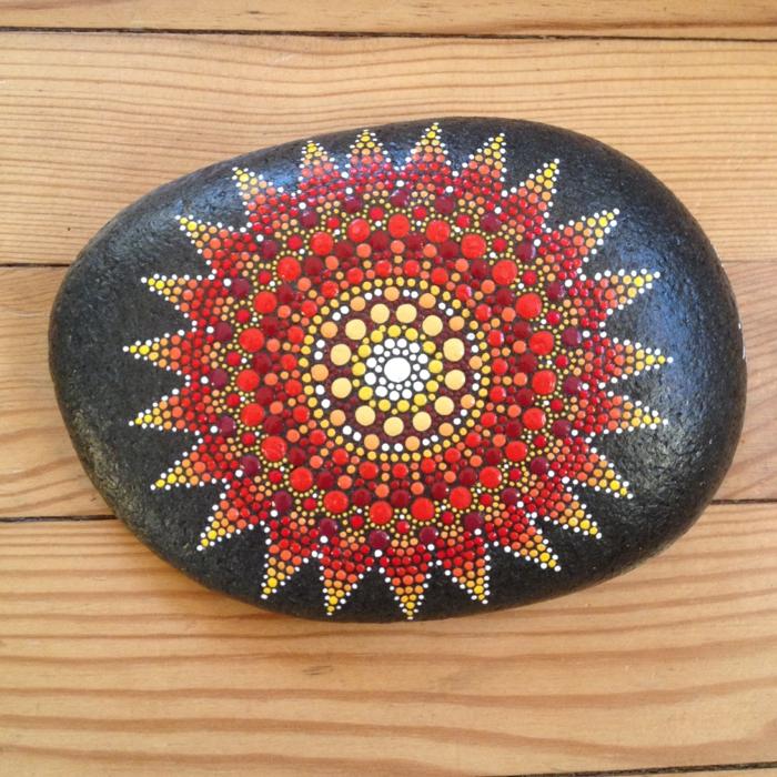 faire peinture sur galets mandala sur une pierre noire