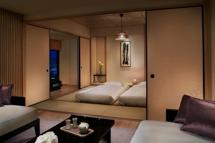 lit futon pour une chambre coucher de style japonais. Black Bedroom Furniture Sets. Home Design Ideas
