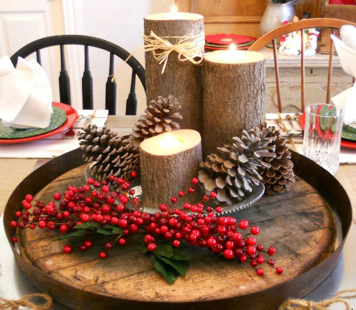 décoration de table de noël pommes de pin et rondins de bois