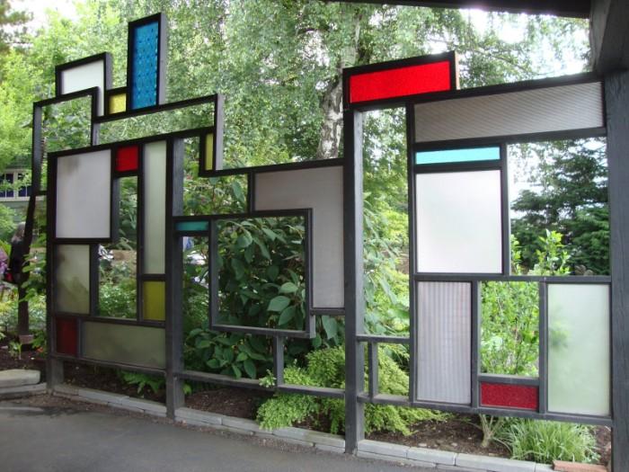 brise-vue jardin construction en métal et verre