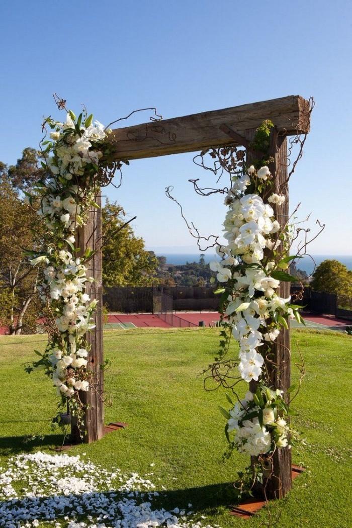 mariage champêtre arche fleurie rustique