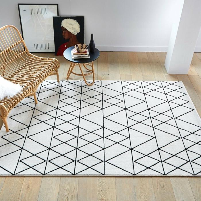 salon meubles en rotin tapis graphique