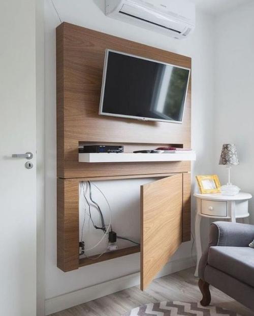 meuble TV grande installation en bois au mur