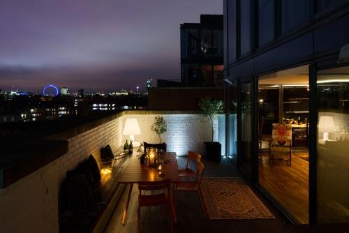 éclairage balcon grande terrasse en briques
