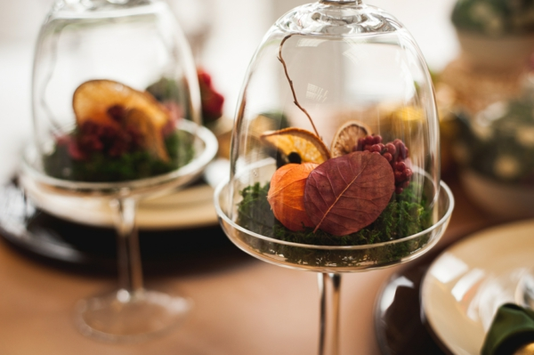 autumn decor with dry flowers and oranges