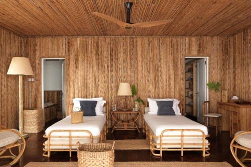 maison de plage en bambou chambre à coucher
