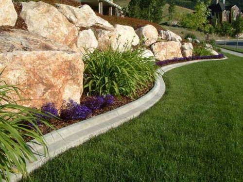 palissade jardin grande rocaille et des parterres de fleurs