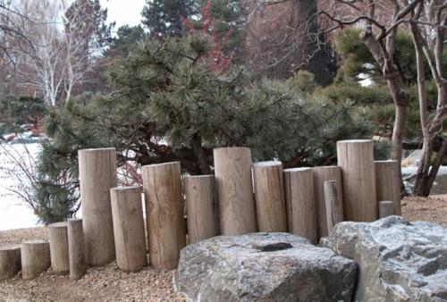 palissade jardin parties cylindriques en bois