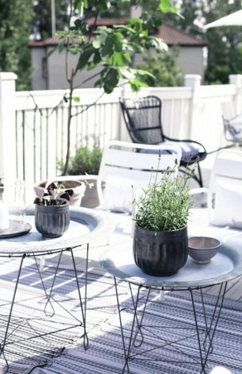 plante en pot terrasse espace couvert de tapis