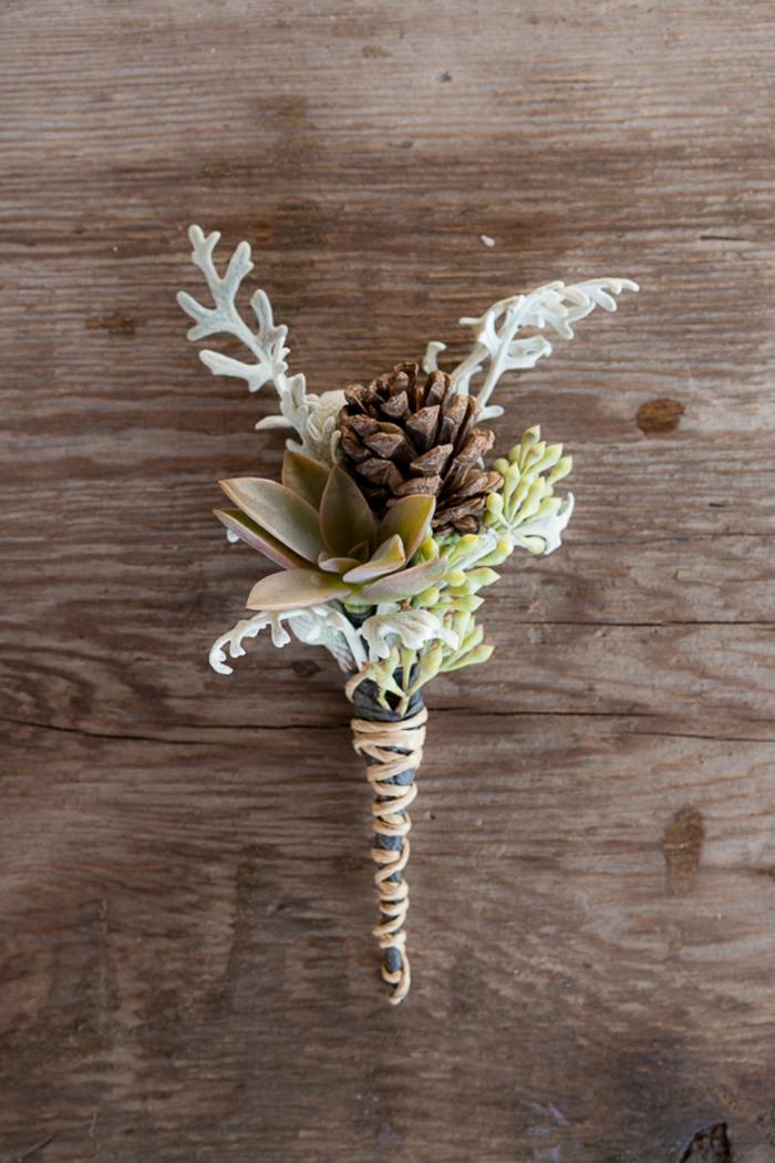 boutonnière mariage idée originale création avec des pommes de pin