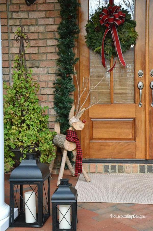 décoration de noël extérieur Rudolf le renne au nez rouge rondins et branches