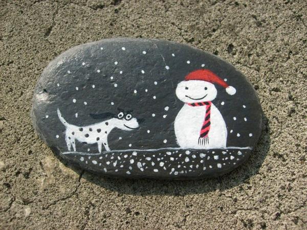 idée de peinture sur galets pour noël bonhomme de neige et chien