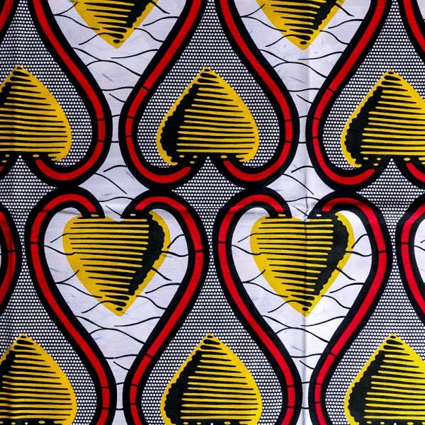 le pagne africain jaune, rouge et noir