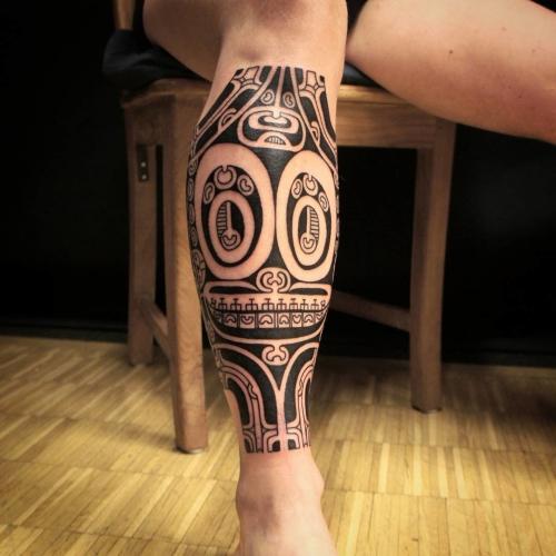 tatouage polynésien deux têtes petite et grande