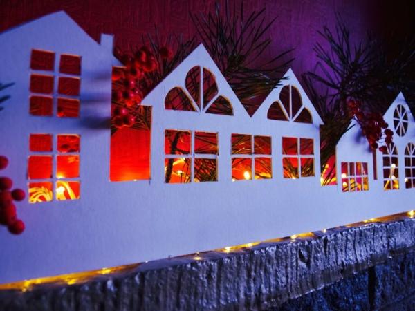fabriquer un village de Noël lumières derrière