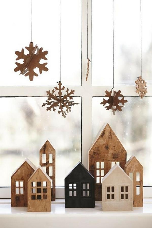 idée déco fenêtre noël village de noël en bois