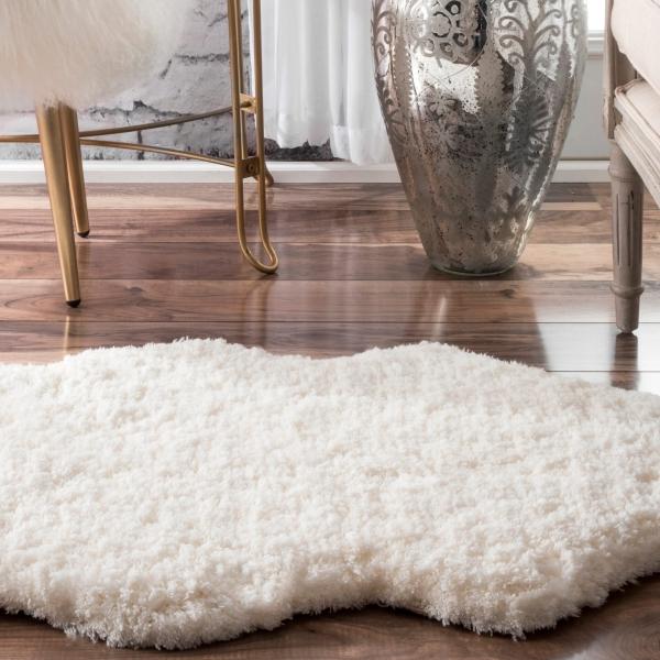 tapis fausse fourrure blanc très épaisse