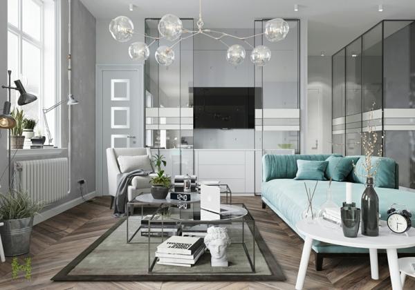 déco salon gris parquet en bois canapé turquoise lustre design