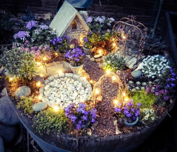 décorer son jardin avec des objets de récupération maison de fée barrel