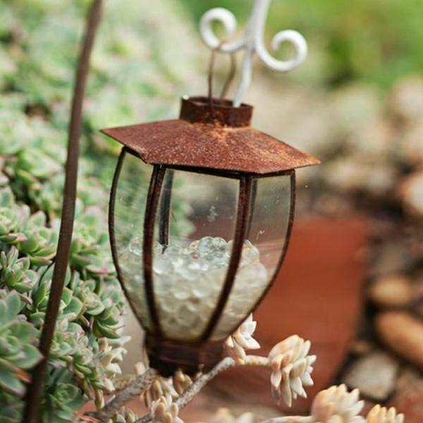 idée déco jardin métal rouillé lanterne