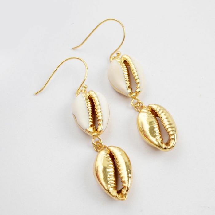 boucles d'oreilles dorées bijoux coquillage