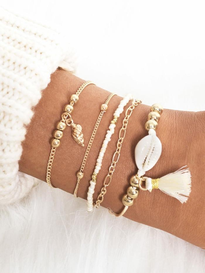 joli bracelet bijoux coquillage avec pompon