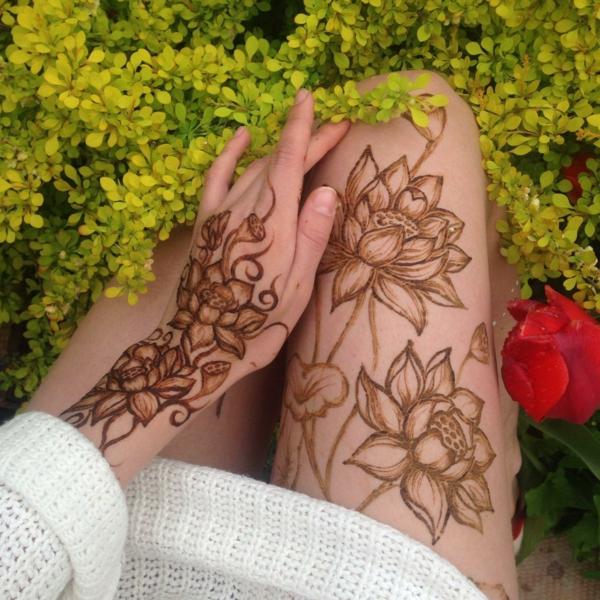tatouage éphémère au henné brun cuisses bras femme