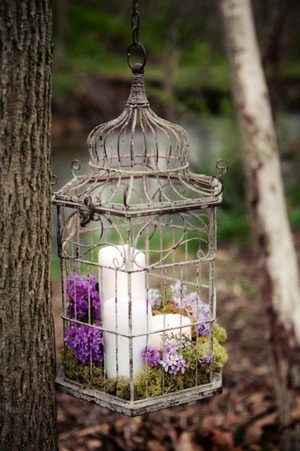 déco cage oiseau accrochée à un arbre