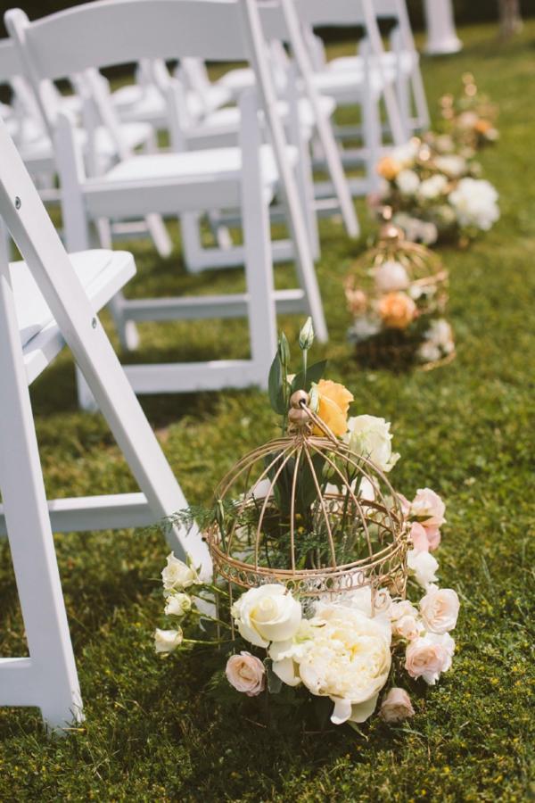 déco cage oiseau mariage marques rangées de chaises