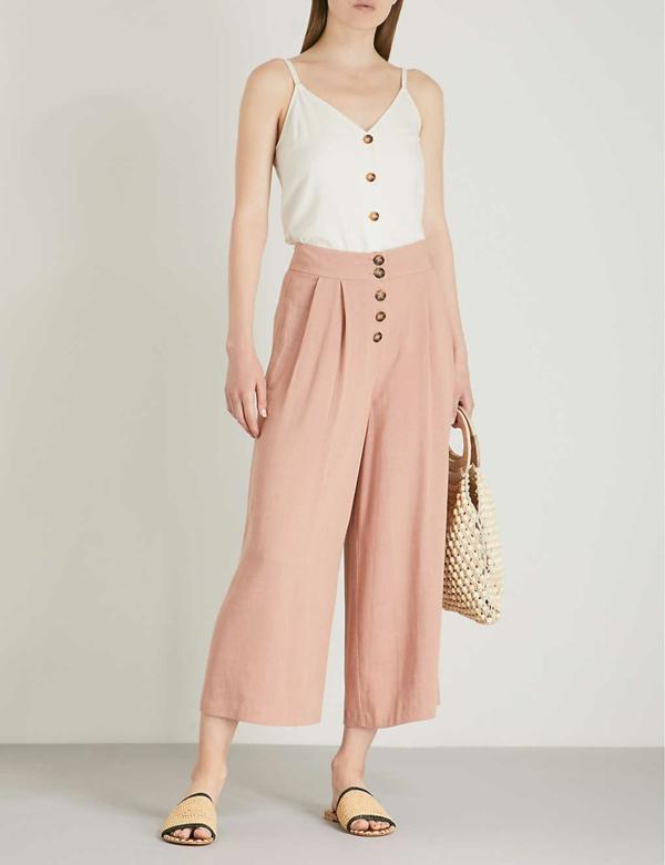 pantalon fluide boutonné en lin couleur pastel