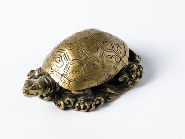 porte-bonheur une tortue en cuivre