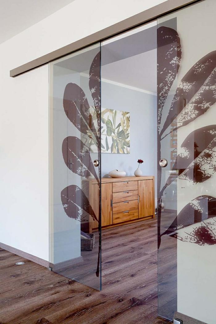 portes coulissantes en applique en verre