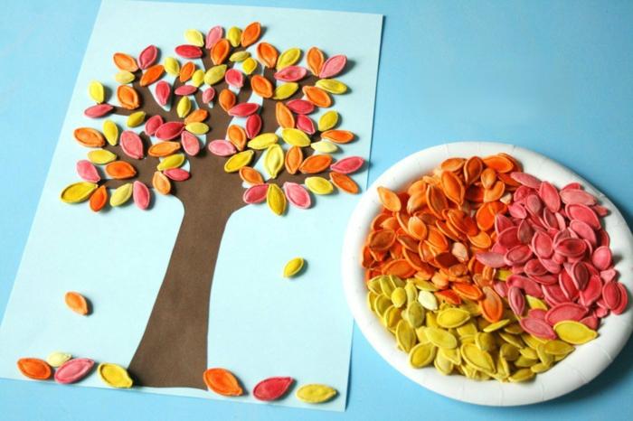 activités manuelles automne avec des graines de citrouille colorés