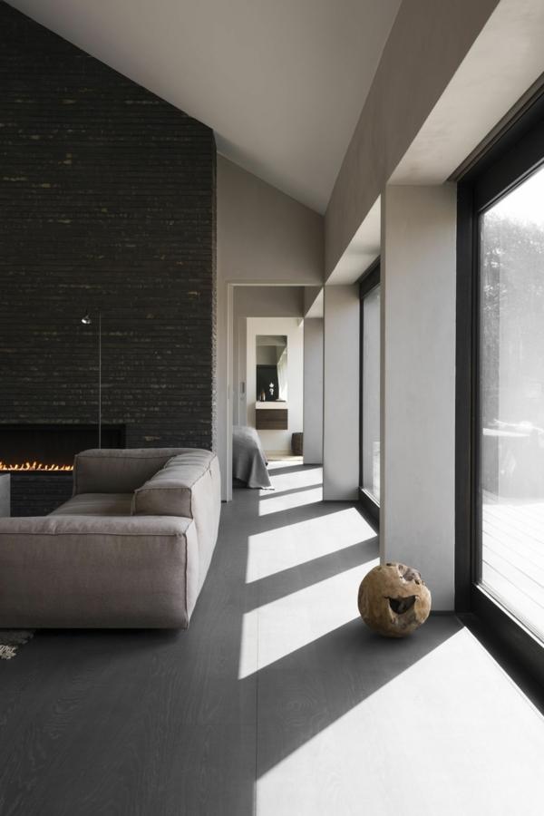 déco salon moderne 2020 parquet pierre sur les murs cheminée