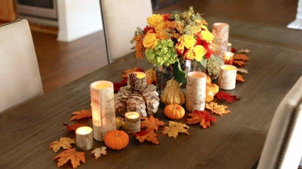 décoration florale d'automne hortensias feuilles bougies roses