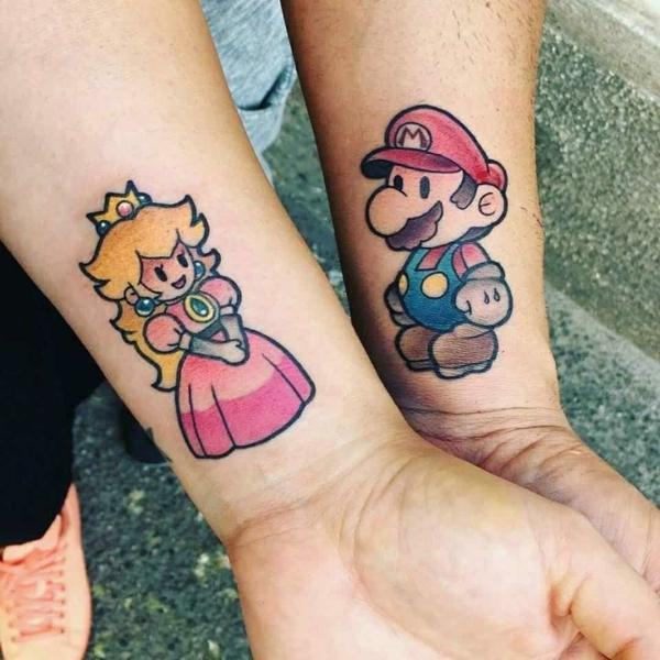 tatouage complémentaire pour couple super mario et sa compagnonne