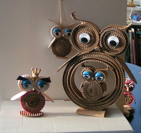 idée décoration Noël à fabriquer soi-même hibous faits de carton ondulé