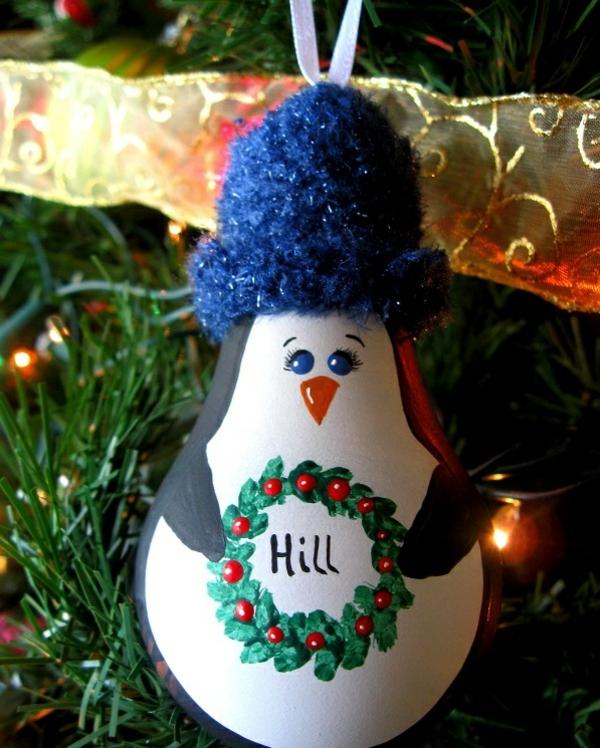 idée déco Noël à fabriquer soi-même pingouin fait d'ampoule électrique