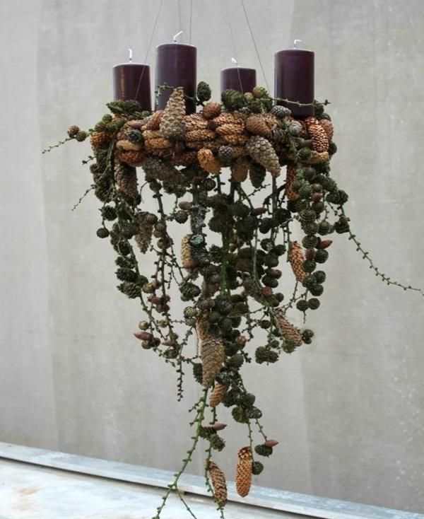 idée de décoration noël tendance chandelier de pommes de pin