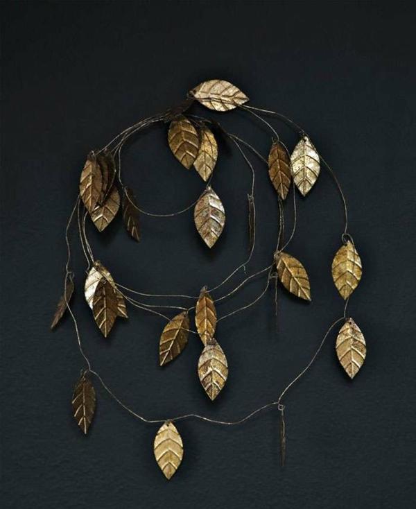idée de décoration noël tendance guirlande de feuilles dorées