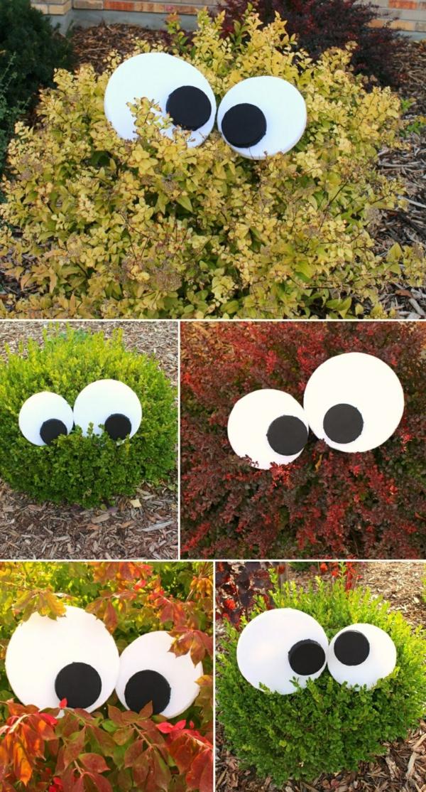 idée de déco extérieure pour halloween arbres et arbustes avec des yeux en mousse