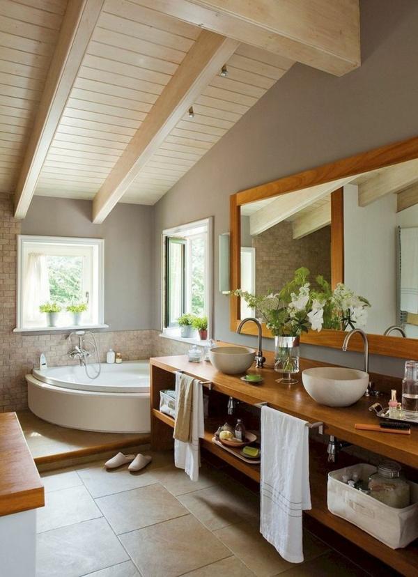 salle de bain sous comble bqignoire en angle mobilier en bois lavabos vasques