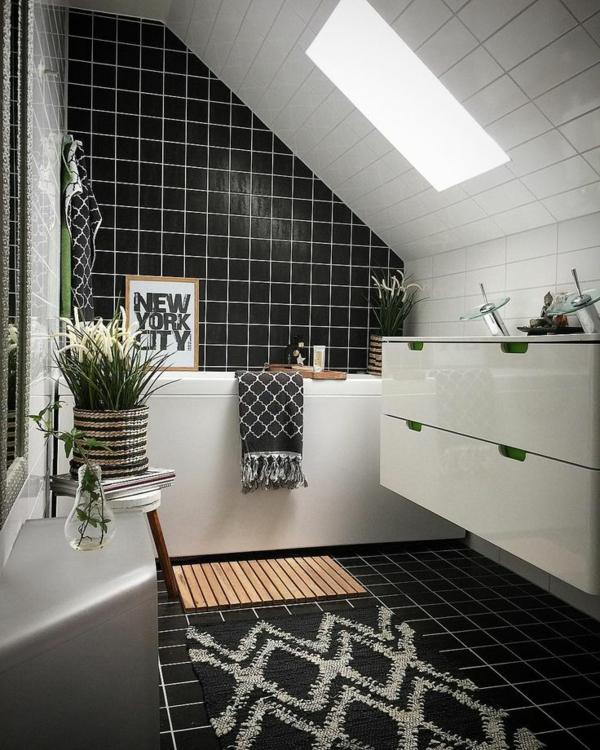 salle de bains sous comble carrelage noir mobilier blanc