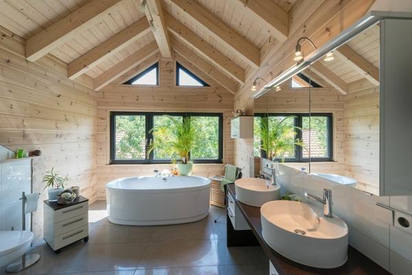 salle de bains sous comble sol granit mur en bois baignoire ovale