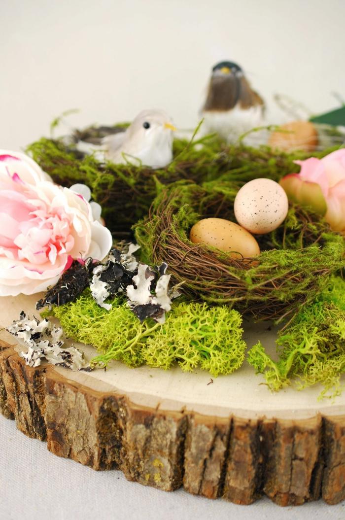 nid de pâques diy sur une rondelle de tronc d'arbre