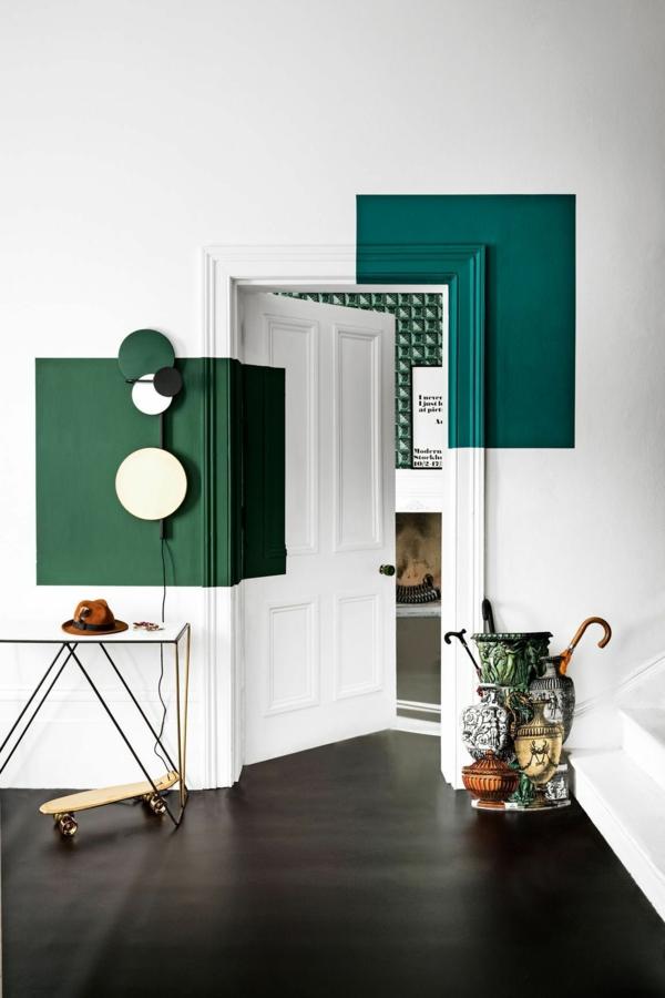 peinture géométrique vert foncé et blanc salon